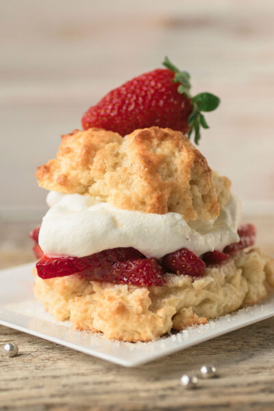 A strawberry shortcake with fresh fruit, whipped cream and a perfectly baked short cake