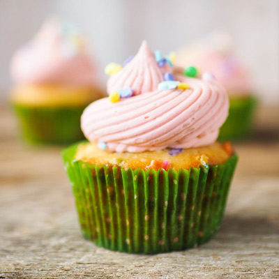 beautiful funfetti cupcake with pink frosting swirl and sprinkles