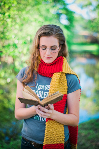 teenager reading and wearing a color block scarf