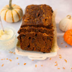 sliced pumpkin bread with cream cheese sauce and pumpkins