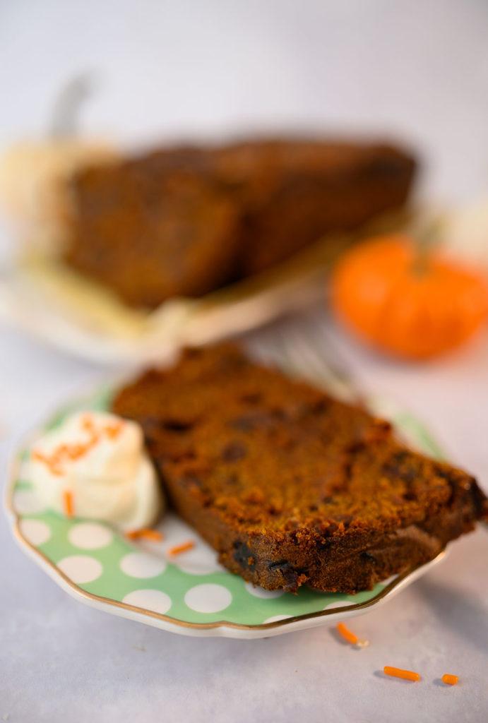 slice of pumpkin bread on a polka dot plate