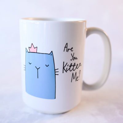 ceramic mug with illustration of a kitten in a crown
