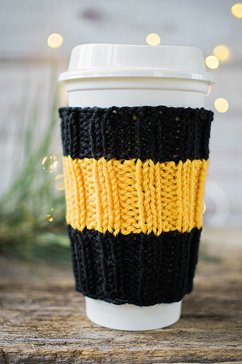 travel cup with hand knit cozy