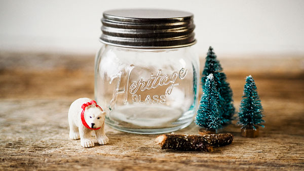 a miniature polar bear with bottle brush trees to be placed in a small mason jar