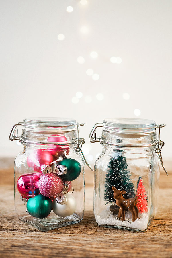 two small decorative jars with Christmas ornaments