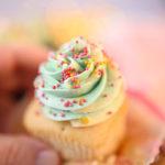 hand holding a pretty cupcake