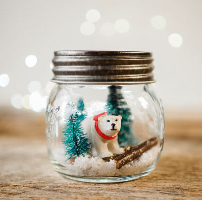 polar bear figure inside a mason jar