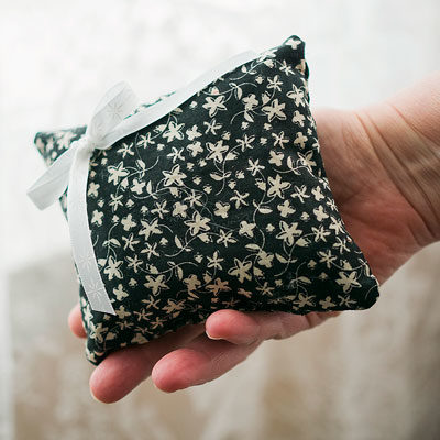 hand holding floral sachet