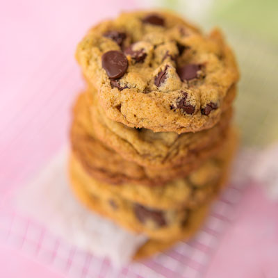 close up of a cookie stack of chocolate chip cookies