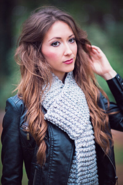 lovely young woman models a rustic garter stitch scarf