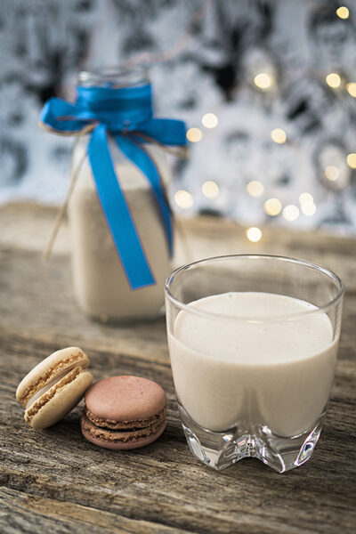glass of Irish cream and macarons