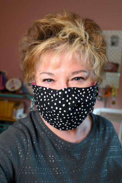 woman wearing a polka dot fabric face mask