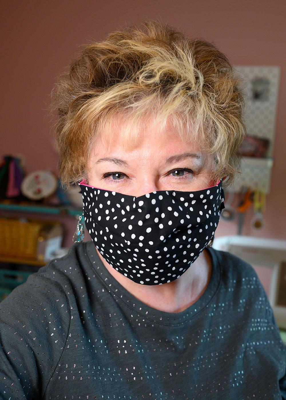 woman wearing a polka dot fabric face mask