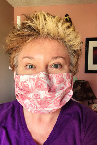 front view of woman in a pink fabric face mask