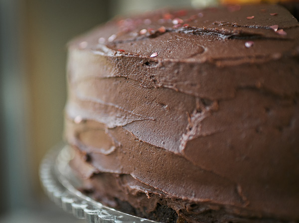 close up of the chocolate frosting on the layer cake