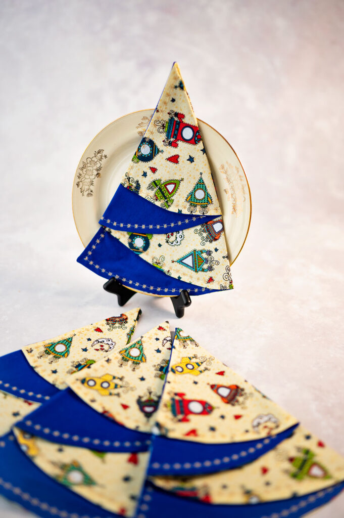 set of 4 christmas tree napkins styled with a dessert plate