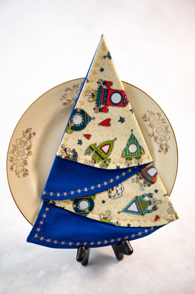 christmas tree napkin styled with a vintage dessert plate
