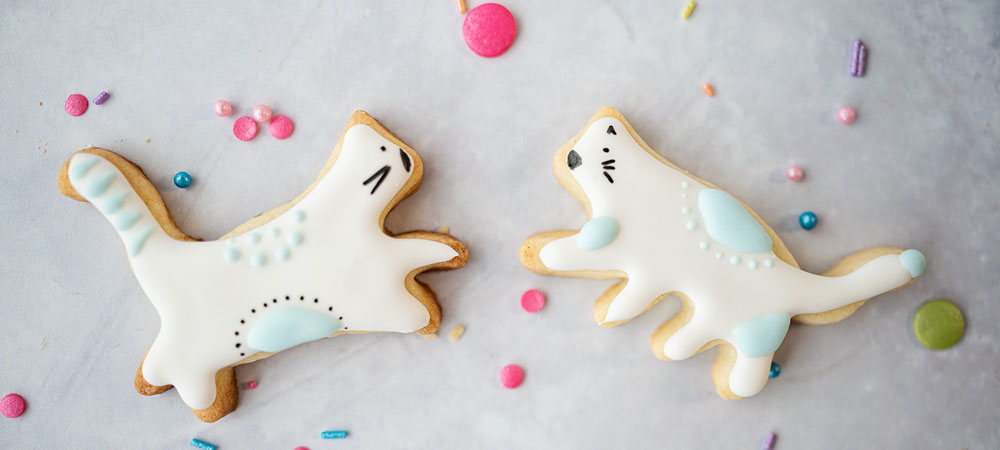 decorated cookies that look like dancing cats