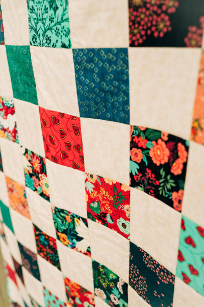 a colorful quilt top made of patchwork blocks