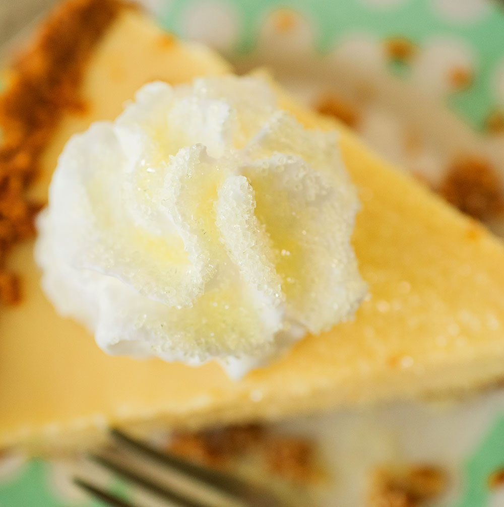 overhead view of the sugar sprinkled whipped cream on top a lemon pie
