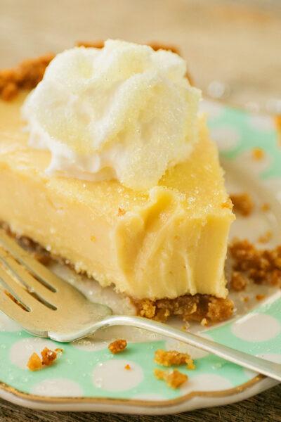 closeup of lemon pie with a big bite taken