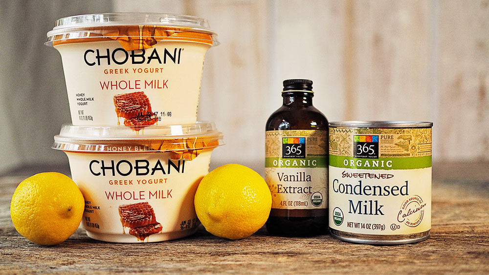 The ingredients for lemon frozen yogurt. Chobani honey flavored greek whole milk yogurt, vanilla, sweetened condensed milk and fresh lemons.