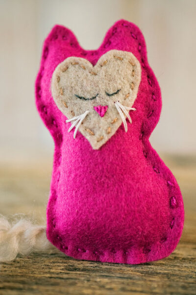 close up of hand sewn felt kitten toy