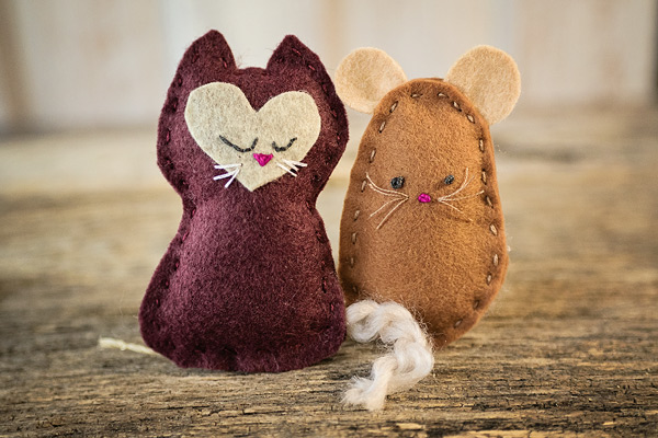 Hand sewn felt kitten and mouse toys shown together