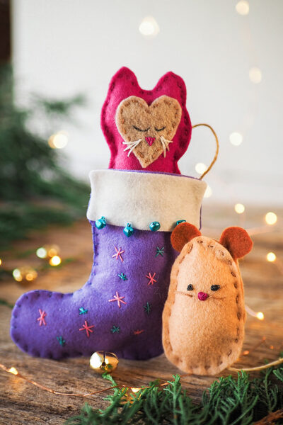 Handstitched toy kitten and mouse with a Christmas stocking
