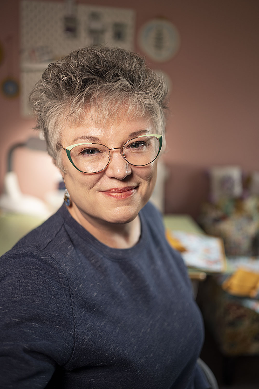 Smiling woman in a sewing room