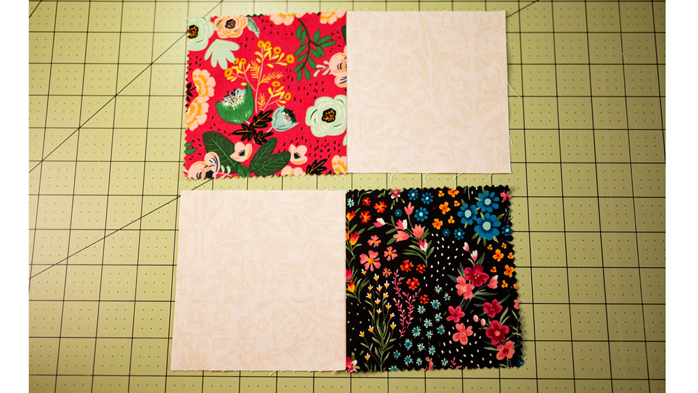 4 fabric squares with each print sewn together with the neutral