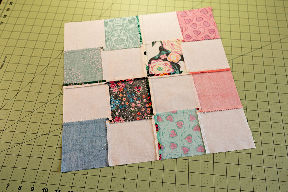 The back side of the quilt top showing all the perfectly pressed seams