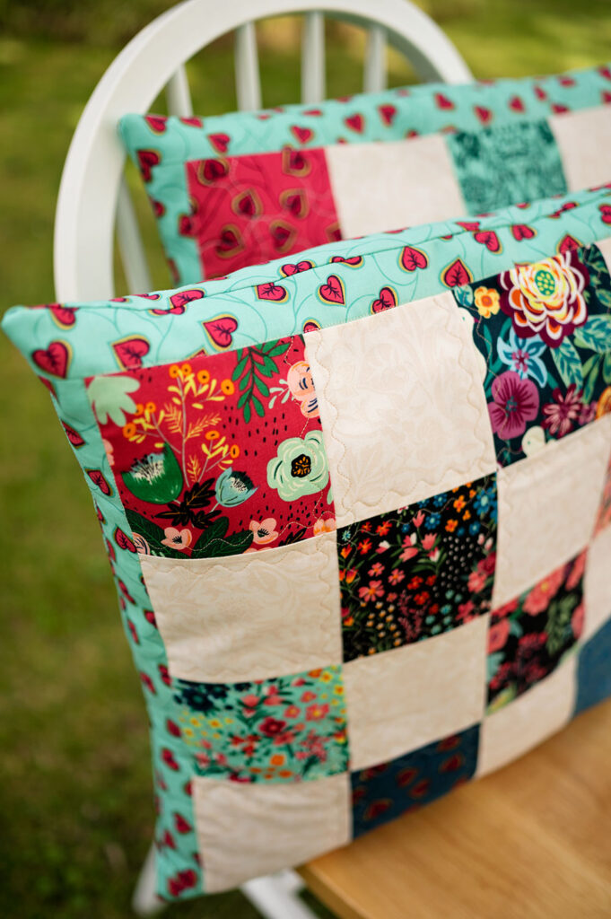 closeup of a colorful patchwork pillow