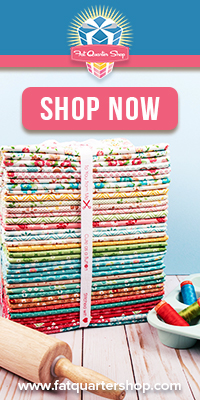 stack of fabric with a rolling pin. this links to an affiliate store for fabric.