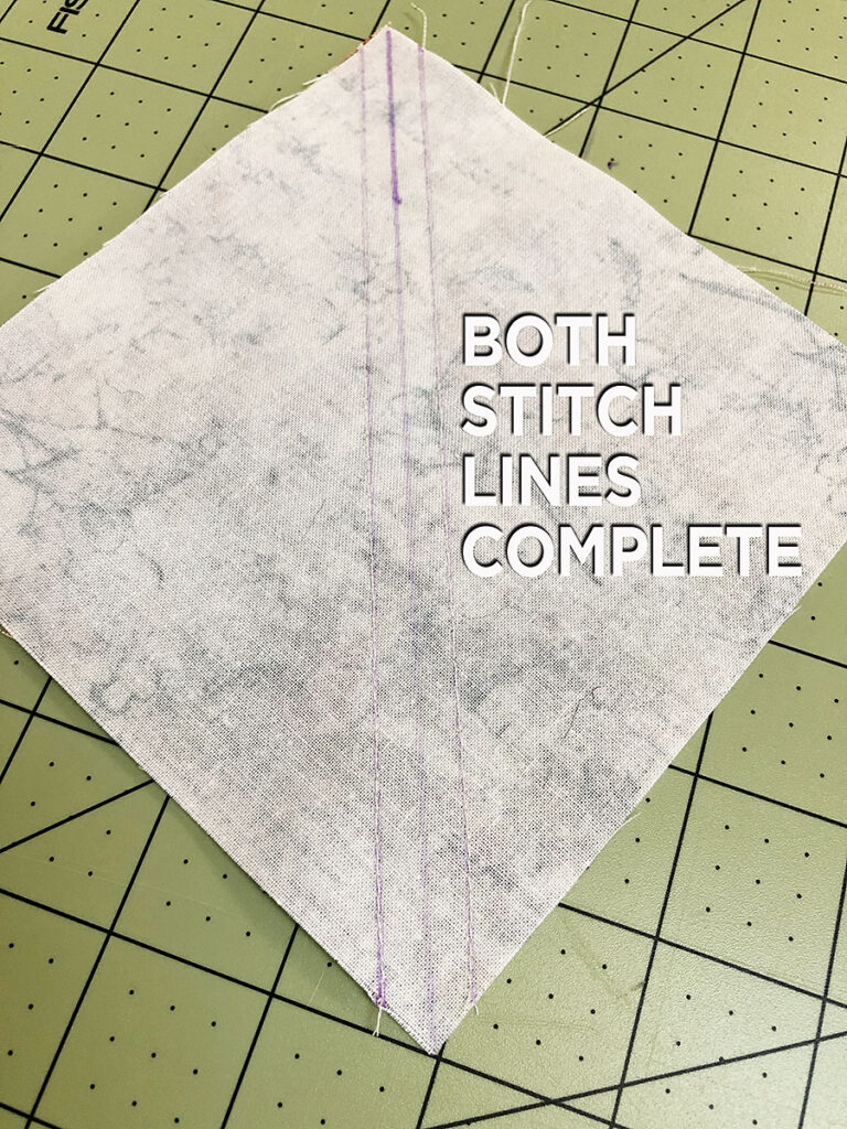 a half square triangle with two stitch lines before cutting
