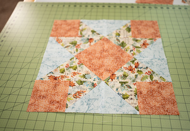 The pieced block on the cutting mat