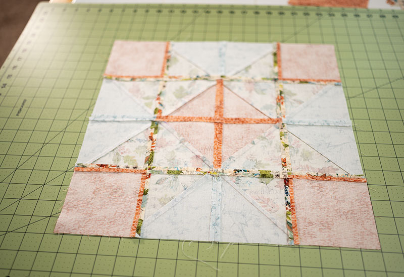 The wrong side of the completed ribbon star quilt block showing the way the seams are pressed