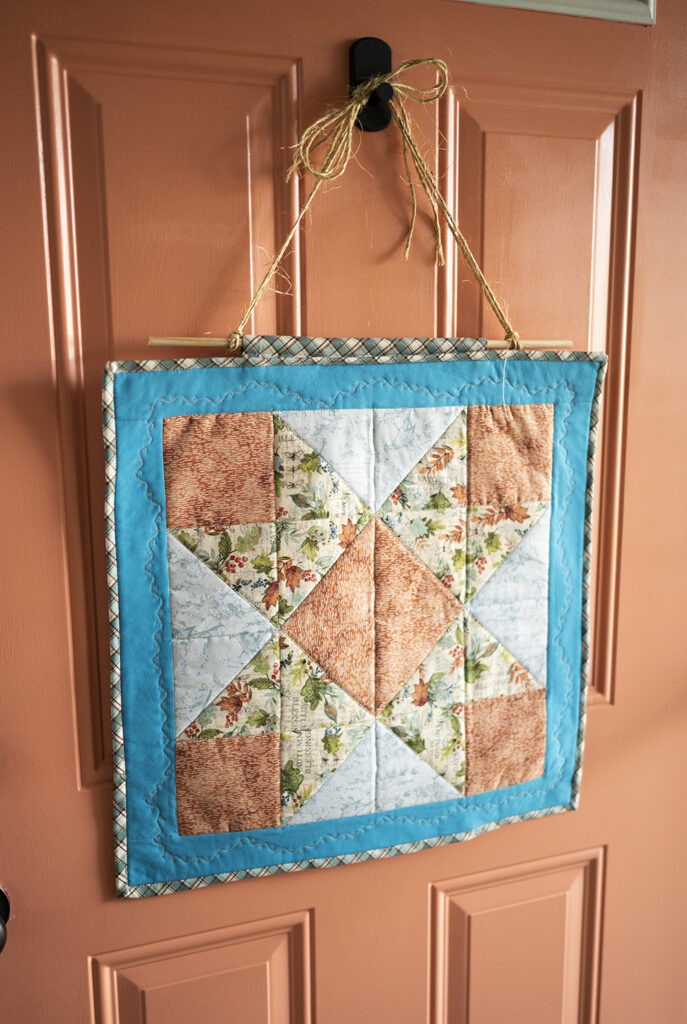small quilt displayed on a front door