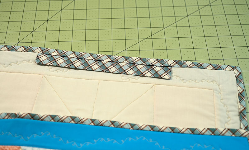 Back of the quilt showing the sleeve sewn into place