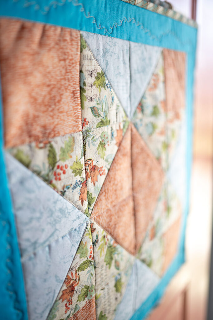 closeup view of a a quilt featuring perfect points