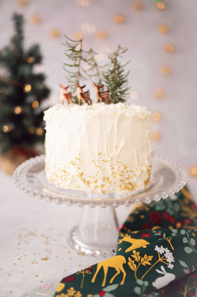 beautiful white cake with miniature deer decorations