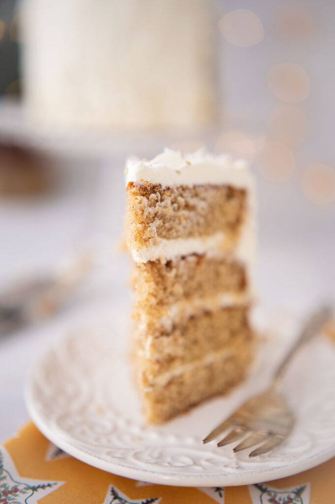 close up of a slice of 4 layer spice cake