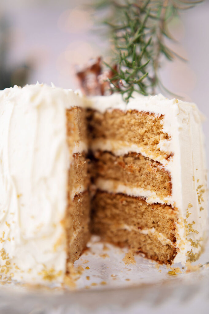 closeup of the 4 layer cake with white chocolate frosting