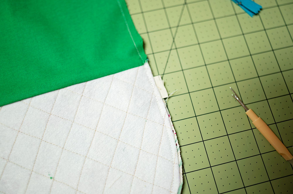 close up of quilted zipper pouch inside out showing stitch line