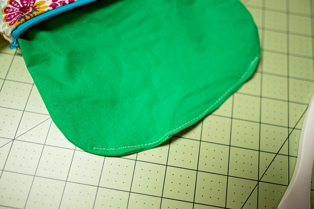 zipper pouch lining is stitched closed after zipper pouch is finished
