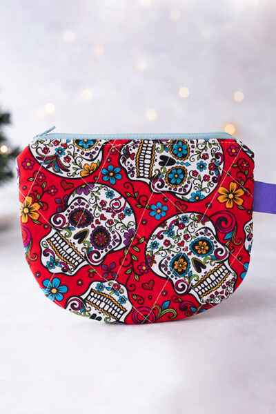 quilted zipper pouch project sewn with colorful red sugar skull fabric