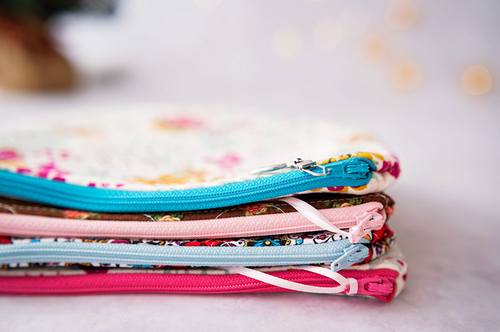 stack of colorful zipper pouch projects