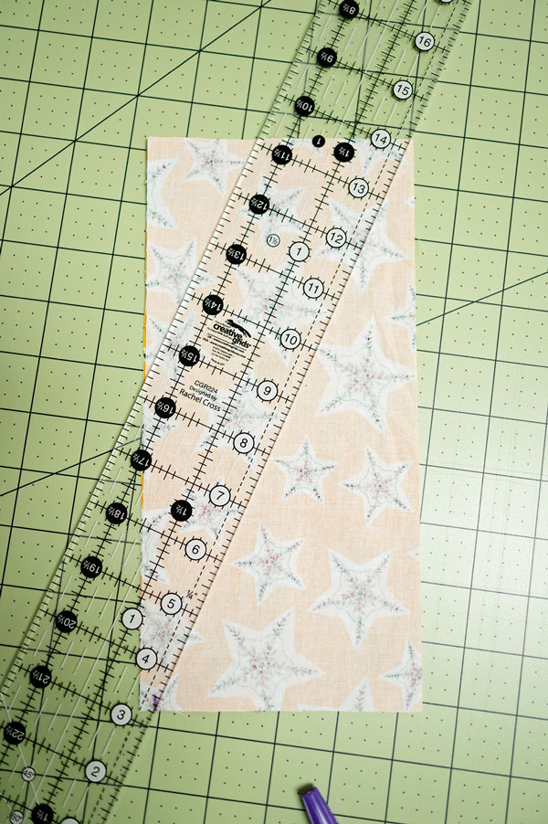 overhead view of a quilting ruler placed on fabric for cutting