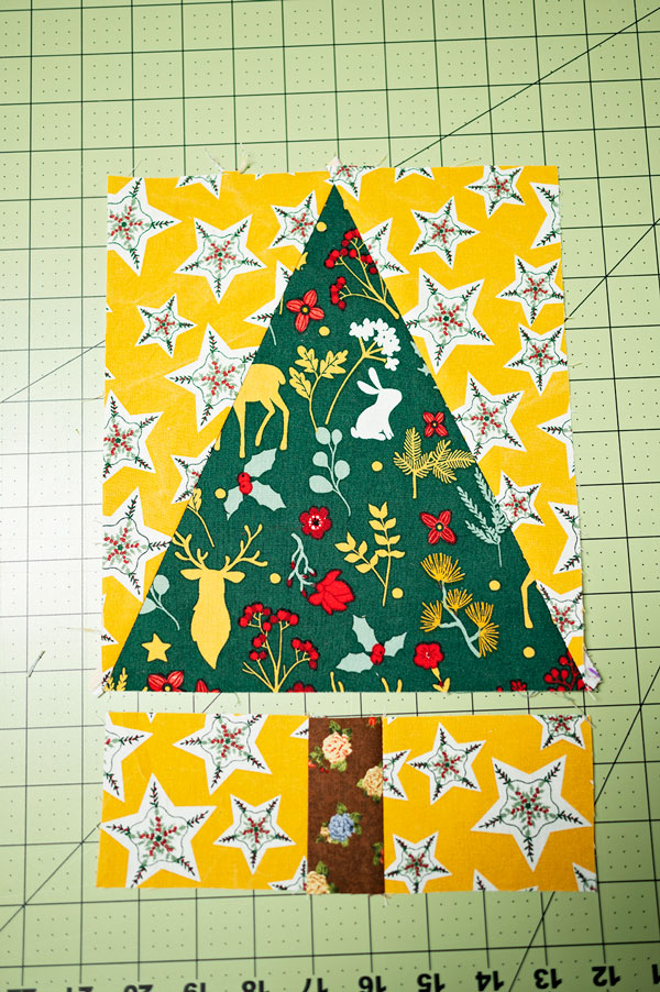 The last step in piecing the tree block together. Piecing the upper and lower part of the tree block into on piece
