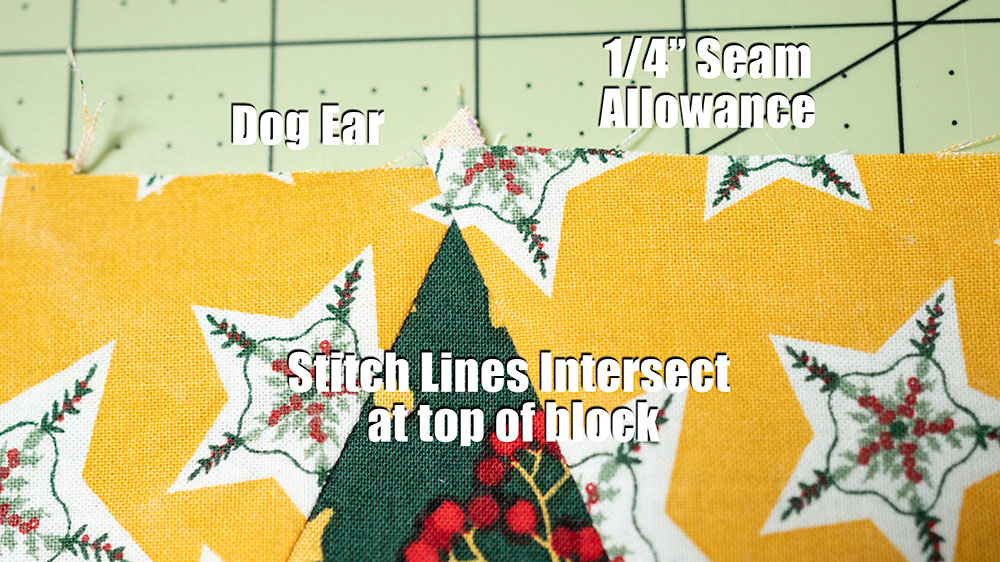 Close up view showing correct seam allowance to achieve points in a quilt block